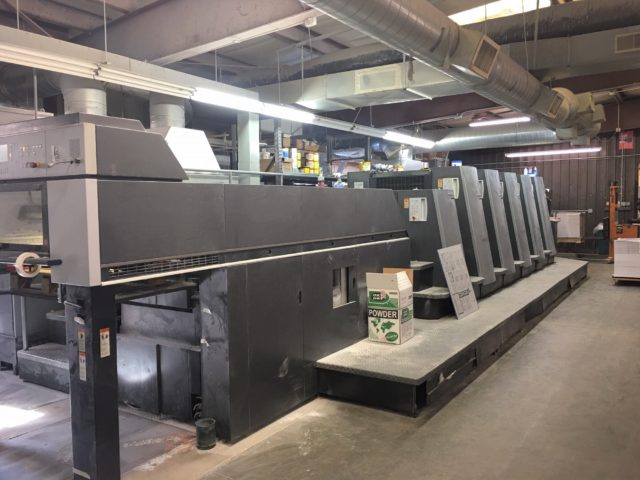 Five-color offset press using environmentally-friendly ink.